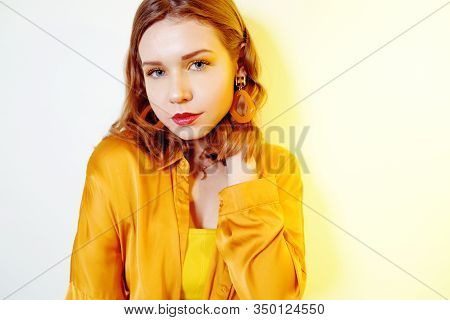 Beautiful Young Girl With A Short Haircut Looks At The Camera. Girl In Yellow, Accessories, More Ear
