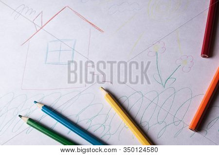 Children's Drawing And Colored Pencils Lie On The Table. Children's Creativity. Children's Problems.