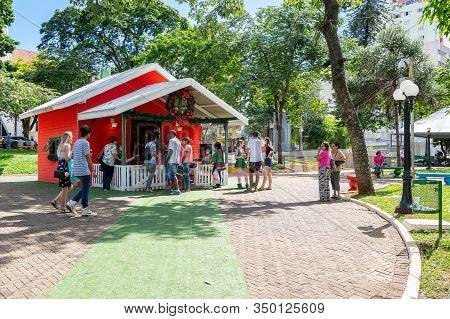 Londrina Pr, Brazil - December 23, 2019: Santa Claus House Being Visited By People At Praca Da Bande