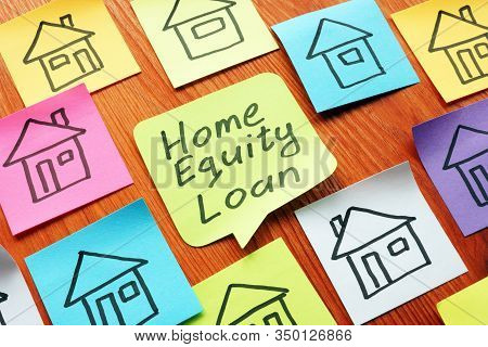 Home Equity Loan Phrase On The Memo Stick. Mortgage Concept.