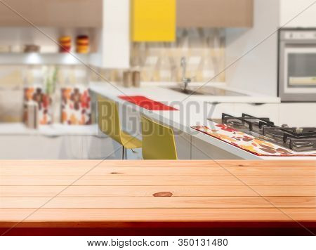 Kitchen, Background. Empty Textured Wooden Table And Kitchen Window Shelves Blurred Background. Sele