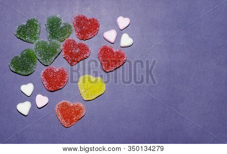 Set Of Heart Shaped Jelly Candies Isolated On Blue Background. Top View, Soft Selective Focus. Color