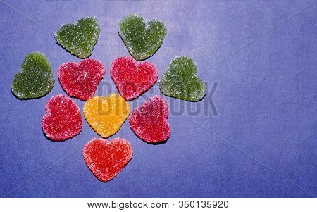 Multi-colored Marmalade Sweets In The Shape Of A Heart Are Laid Out In The Shape Of A Flower. Marmal