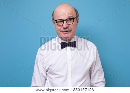 Doubtful Senior Aged Spanish Man Looking With Mistrust.