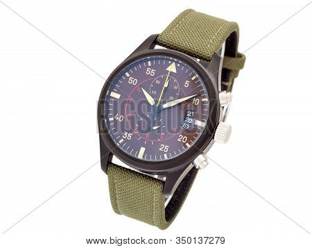 Wristwatch With A Green Textile Strap And Brown Iron Case With Arrows And Numbers, Isolated Face Of