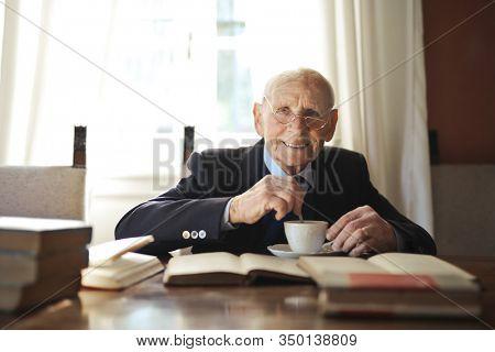 old businessman drinks a coffee