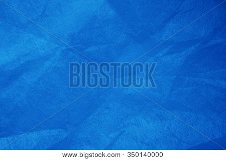 Classic Blue Crumpled Wrapping Paper Background And Texture. Bright Blue Background For Site, Web, B