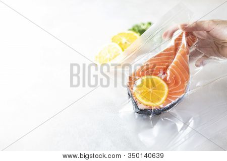 Salmon Fillets In A Vacuum Package. Sous-vide, New Technology Cuisine.