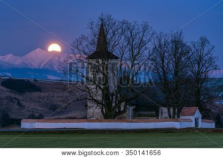 Full Moon On The Sky, Mountains At Background  And Lonely Gothic Church Of All Saints Ludrová, Slova