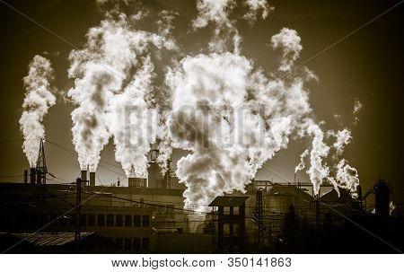 Dark Smoke From Chimney In Factory. Air Pollution In City Ruzomberok, Slovakia