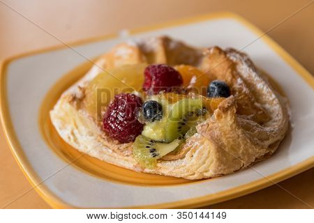 Tasty Danish Pastries Served With Fruit As A Dessert