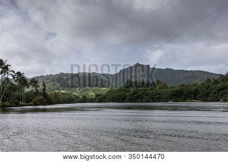 Nawiliwili, Kauai, Hawaii, Usa. - January 16, 2020: Wide Gray South Fork Wailua River Meanders Betwe