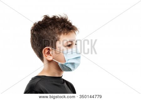 Human population virus, infection, flu disease prevention and industrial exhaust emissions protection concept - teenager boy wearing respiratory protective medical mask side view white isolated