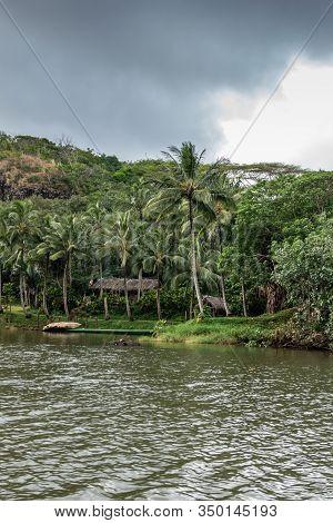 Nawiliwili, Kauai, Hawaii, Usa. - January 16, 2020: Straw Huts On Shore Of South Fork Wailua River W