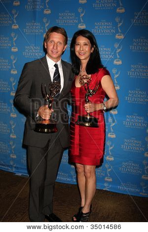 LOS ANGELES - JUN 17: Brad Bell, Christine Lai-Johnson at the 38th Annual Daytime Creative Arts & Entertainment Emmy Awards at Westin Bonaventure Hotel on June 17, 2011 in Los Angeles, CA