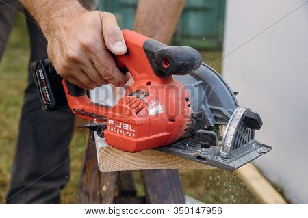 10 February 2020 Chicago Il: Milwaukee Power Tools Carpenter Cutting Wooden Plank Hand Held Electric