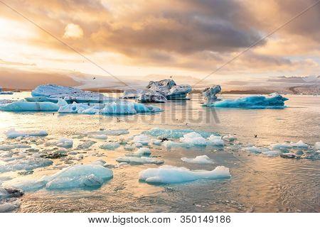 Icebergs Floating In Jokulsarlon Glacier Lagoon Lake At Sunset. Great Tourist Attraction In Iceland