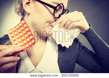 Sickness And Diseases At Work. Young Unhealthy Businesswoman With Tissue Having Flu Grippe. Secretar