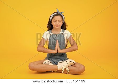Inner Calmness. Yoga Meditation. Little Child Do Meditation In Healthy Pose. Small Girl Enjoy Medita
