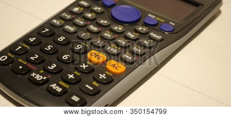Black Scientific Calculator Closeup On White Background. Calculation And Engineering Concept.