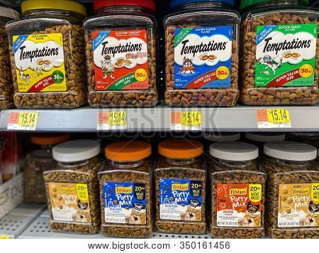 Orlando, Fl/usa-2/6/20:   A Display Of Temptations And Party Mix Friskies Cat Food At A Walmart Supe