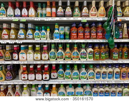 Orlando,fl/usa -2/8/20:the Salad Dressing Aisle Of A Publix Grocery Store With A Variety Of Bottles