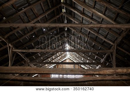 Old Roof Trusses Covered With Ceramic Tile On A Detached House Under Construction, Visible Roof Elem