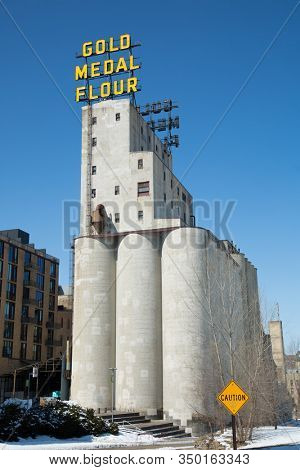 MINNEAPOLIS-MINNESOTA, APRIL 1, 2018:   Arguably one of the most iconic riverfront sights in Minneapolis, the twin Gold Medal Flour signs were built in 1910.   The sign is part of a vibrant riverfront