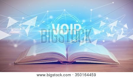Open book with VOIP abbreviation, modern technology concept