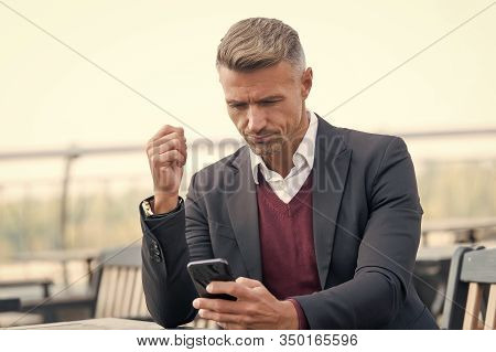 Mobile Is Lifestyle Not Technology. Mature Businessman Use Mobile Device In Cafe. Handsome Man Hold