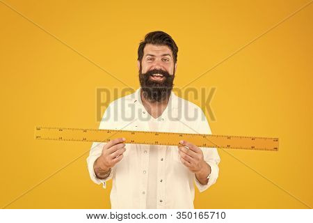 There Is No Substitute For A Great Teacher. Happy Teacher Holding Ruler On Yellow Background. Maths
