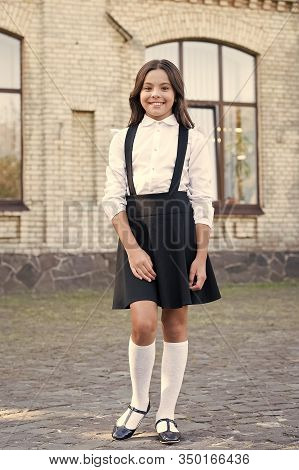 Style For Every Story. Schoolgirl In Classy Retro Uniform. Vintage Kid Fashion And Beauty. Old Schoo