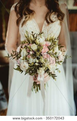 Wedding Bouquet. Bride In Veil Hold Decorative Roses Flowers. Preparation For Ceremony. Floral Backg