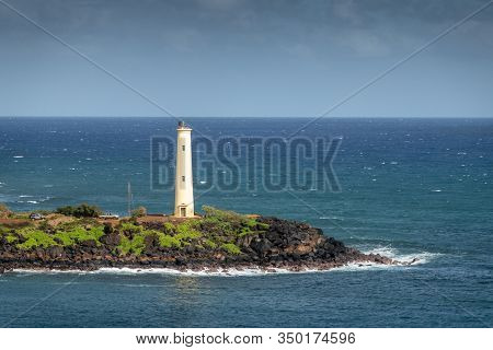 Nawiliwili, Kauai, Hawaii, Usa. - January 17, 2020: Closeup Of Yellow Ninini Lighthouse On Black Oce