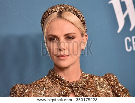 LOS ANGELES - JAN 28:  Charlize Theron arrives for the Costume Designers Guild Awards on January 28, 2020 in Beverly Hills, CA