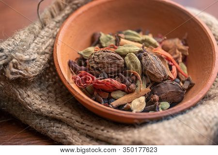 Mix Spices And Herbs In Earthen Bowl On Dark Background, Indian Spices Food And Cuisine Ingredients