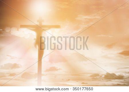 Silhouette Jesus Christ Crucifixion On Cross Over Orange Sunset Light Background, Prayer And Praise