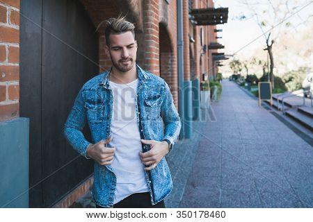 Man Walking On The Street.