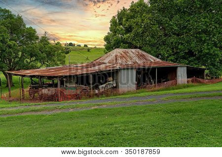 Old Dilapidated Shed Filled With Farm Vehicles And Implements Used By Early Settlers In The Past, Wi