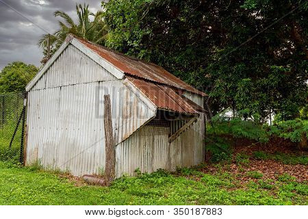 Old Corrugated Iron Shed With Push Out Windows In A Lush Green Garden