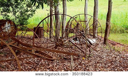 Old Rusted Horse Drawn Wagon Wheels Used As Farm Machinery By The Early Settlers In Australia