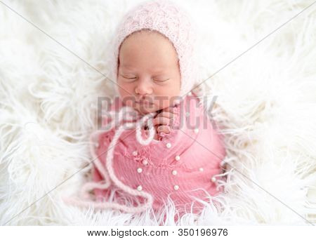 Lovely sleeping newborn in knitted hat