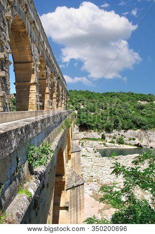 Famous Pont Du Gard Bridge In Languedoc Roussilllon Region,france