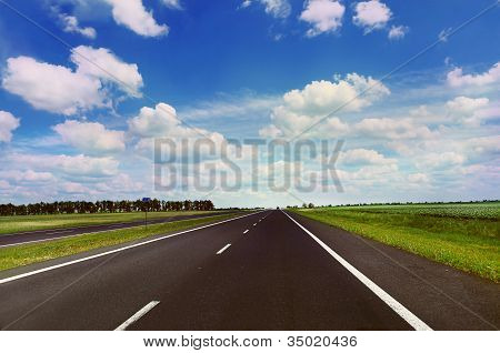 Empty Highway In Sunny Day