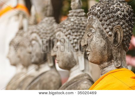 Statues of Buddha in a row  Wat Yai Chai Mongkol, Ayutthaya in Thailand poster