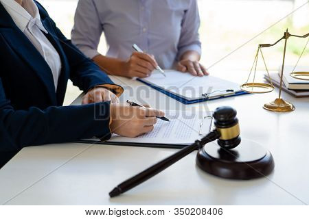 Female Lawyer Explaining Legal Situation And Discussing With Contract Papers, Concepts Of Law, Justi
