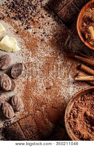 Ingredients For Making Chocolate Background. Cocoa, Cocoa Butter, Sugar, Cinnamon And Coconut Oil On