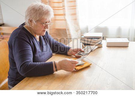 Memory. Eldery Woman Looking Vintage Photos. Family Memory