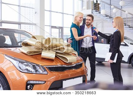 A man makes a gift - a car to his wife. She is surprised at this. They are very happy about