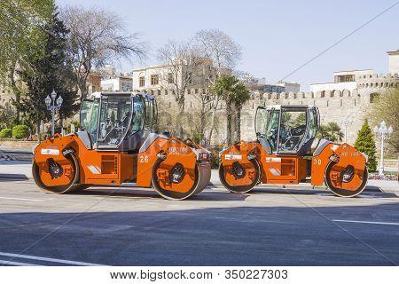 Azerbaijan, Baku-april 17, 2017; Road Equipment Is Working On Road Repairs. Heavy-duty Machinery Wor
